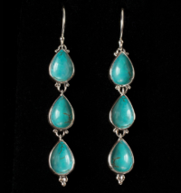 Tibetan Turquoise Dangle Earrings handcrafted in Sterling Silver with teardrop shaped Turquoise gemstones