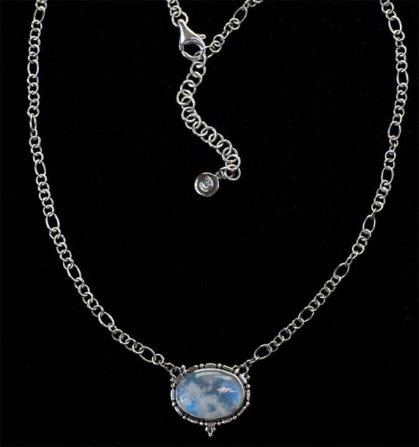 Oval Rainbow Moonstone Necklace handcrafted in Sterling Silver with a Balinese design