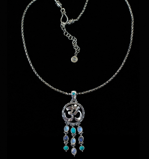 Dangling Gemstone Om Necklace handcrafted in Sterling Silver.